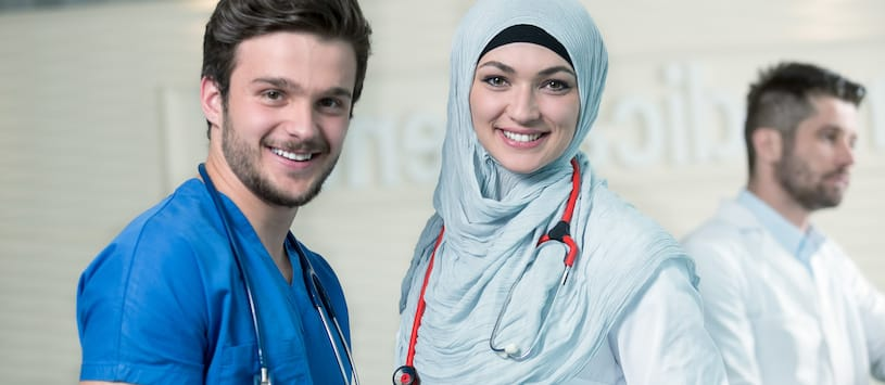 A male medical assistant with a female doctor wearing a hijab. For a thorough Medical Assisting Program come to NWSC.